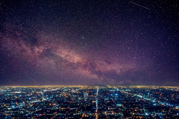 Photo of city and night sky