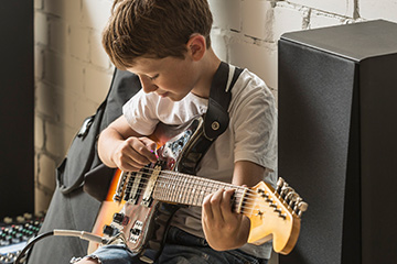 Boy playing guitar.
