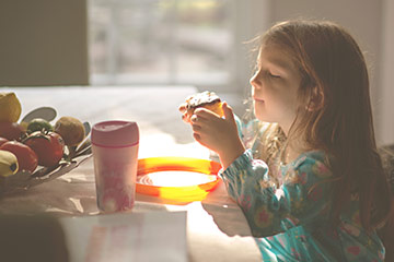 Young girl eating a cake