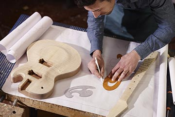 Man building electric guitar.