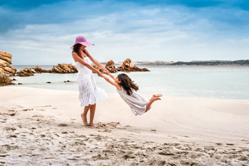 mother and daughter on a beach