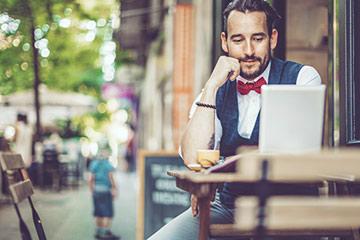 Man outside a coffee shop
