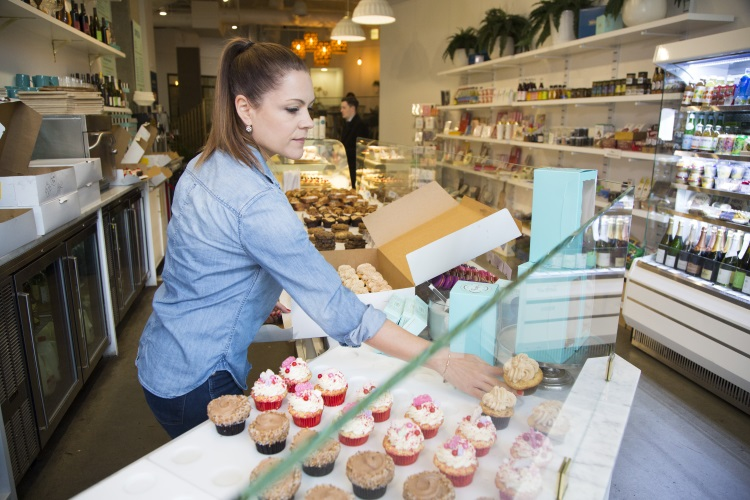 Image of Trophy Cupcakes owner and cupcakes